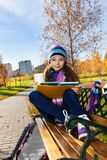Girls with books after school in park Stock Image