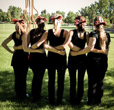Girls with bows in their hair from the back. A group of girls in the the park with matching bows in their hair royalty free stock photo