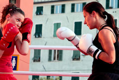 Girls boxing. Demonstration of Kickboxing movements during the Festival of Sport in 2009 at the Porto Antico di Genova royalty free stock photography