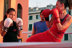 Girls boxing. Demonstration of Kickboxing movements during the Festival of Sport in 2009 at the Porto Antico di Genova stock image
