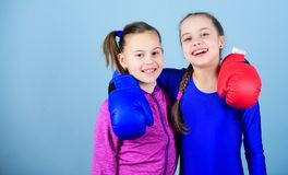 Girls in boxing sport. Boxer children in boxing gloves. Confident teens. Female boxers. Boxing provide strict discipline. Girls cute boxers on blue background royalty free stock photos
