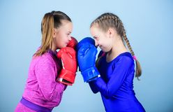 Girls in boxing sport. Boxer children in boxing gloves. Girls cute boxers on blue background. Friendship as battle and. Competition. Pass boxing challenge. Test royalty free stock image