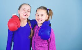 Girls in boxing sport. Boxer children in boxing gloves. Confident teens. Female boxers. Boxing provide strict discipline. Girls cute boxers on blue background stock image