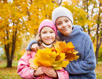 Girls and boy at autumn Stock Photos
