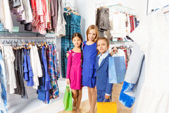 Girls and boy with colorful shopping bags together Royalty Free Stock Image