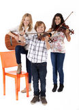 Girls and a boy with musical instruments Stock Photos