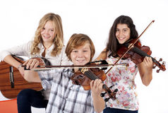 Girls and a boy with musical instruments stock photo
