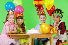 Girls and boy in party hats and crowns Stock Photography