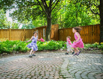 Girls and a Boy Playing Outside at an Easter Party Stock Image