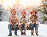 Girls and boy playing on a winter walk Royalty Free Stock Photography