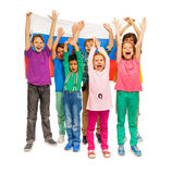 Girls and boys with the flag of Russian Federation. Group of girls and boys raising their hands up and standing against the flag of Russian Federation, isolated royalty free stock images