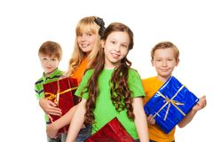 Girls and boys holding presents Royalty Free Stock Photo