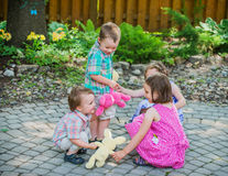 Girls and Boys Playing Ring Around the Rosie Royalty Free Stock Photography