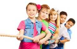 Girls and boys pull the rope together Stock Photo