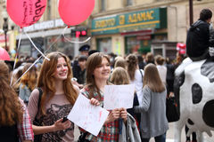 Girls with broadsheet. MOSCOW - APRIL 22: Girls with broadsheet Ira hug, pat pussy  having fun on the holiday of spring and bubbles, Dreamflash, on Apr 22, 2012 Royalty Free Stock Image