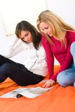 Girls browsing magazine Stock Image
