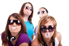 Girls with bubble gum. Group of young girls with bubble gum on white background royalty free stock photography