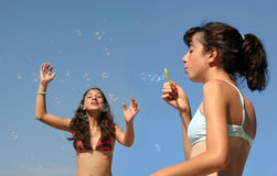 Girls with bubbles Stock Photos