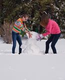 Girls Building a Snowman Royalty Free Stock Photo