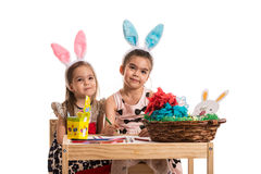Girls with bunny ears make a wry faces Royalty Free Stock Images