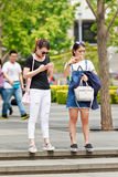 Girls busy with their smart phone, Beijing, China Royalty Free Stock Photography