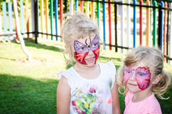 Girls with butterfly face painting royalty free stock image