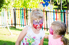 Girls with butterfly face painting Royalty Free Stock Photos