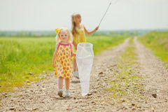 Girls with butterfly net having fun Stock Photo