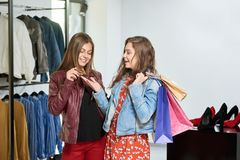 Girls buying clothes during shopping at the mall. royalty free stock images