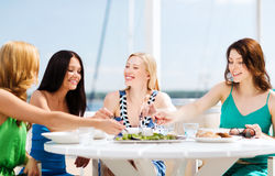 Girls in cafe on the beach Stock Photo