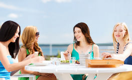 Girls in cafe on the beach Stock Photography