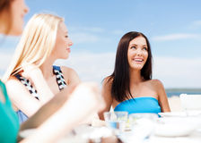 Girls in cafe on the beach Stock Photos