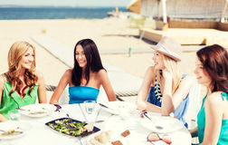 Girls in cafe on the beach Stock Image