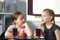 Girls in cafe with juice Royalty Free Stock Image