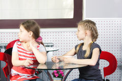 Girls in cafe looking sideway Royalty Free Stock Images