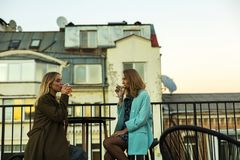 Girls in cafe on rooftop stock photos