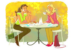 Girls in cafe. Girls are sitting and chatting in cafe Stock Image
