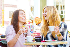 Girls in a cafe. Two girls having fun in a cafe Stock Image
