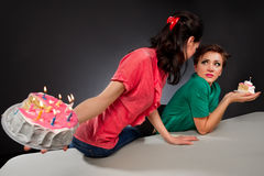 Girls with cake. Two glamour girls with cake Royalty Free Stock Image