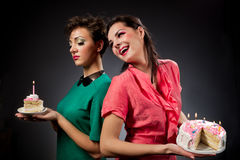 Girls with cake. Two glamour girls with cake Stock Photos