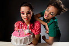 Girls with cake. Royalty Free Stock Images