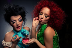Girls with cake. Royalty Free Stock Image