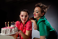 Girls with cake. Two glamour girls with cake Stock Images
