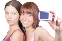 Girls and a camera Royalty Free Stock Photo