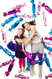 Girls in candies Royalty Free Stock Image