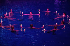 Girls with candles in a circle in pool at Show Olympic champions Royalty Free Stock Image
