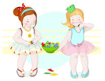 Girls and candy. Girls having fun and eating candy Stock Images