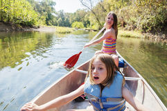 Girls canoeing river Royalty Free Stock Photography
