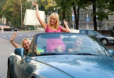 Girls in the car after shopping Stock Photos