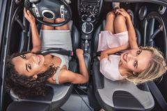 Girls in car Stock Image